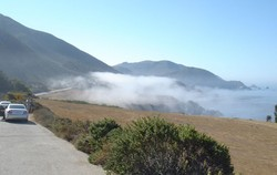A sudden break in the dense fog provides a spectacular vista down the coast towards Big Sur.
