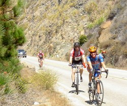 Look Closely over the front rider's left shoulder.  