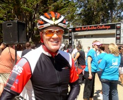 Posing for the camera, Randy smiles just after he passes through the final gates at the finish of the 2008 Best Buddies:Hearst Castle ride.
