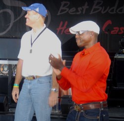 Randy was honored on stage for his help by the Best Buddies Foundation.  Randy along with Olympic Champion Carl Lewis smile as others are honored as well.
